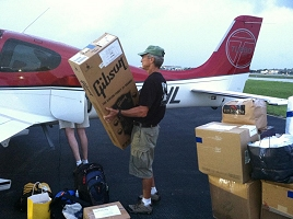 Haiti Relief Flight Loading Airplane